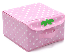 Small childrens pink clothes storage boxes